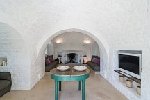 Trullo Tempesta_living area with TV and fireplace