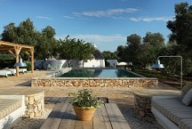 Trulli Bianchemura_pool area with deckchairs and cozy seating