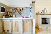 Trulli Matale_dependance kitchen-living with fireplace